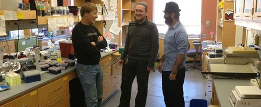 Charlie Giardina and his students Anton Kuratnik and Avi Chopra (left to right) planning experiments in the lab